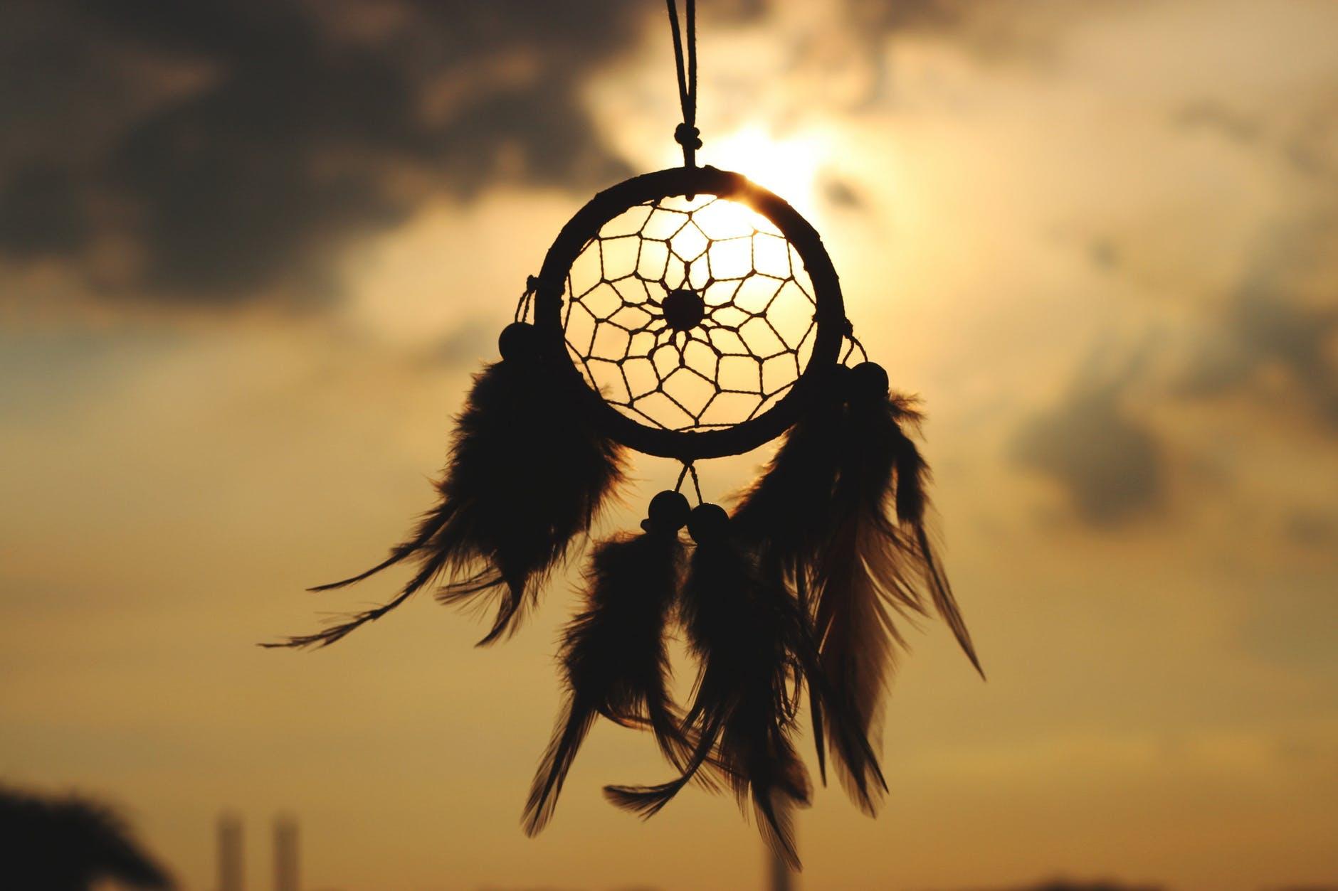Dreamcatcher in darkened sky