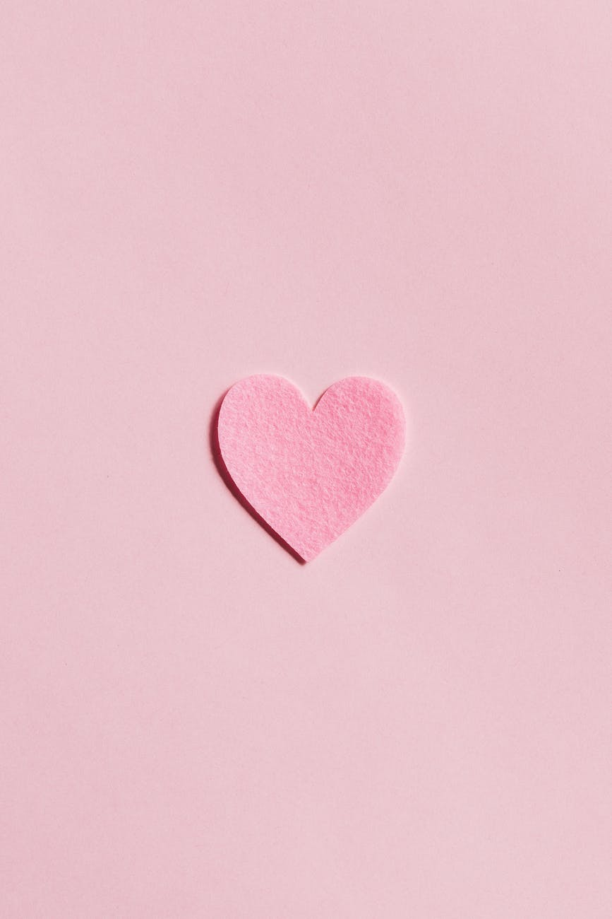 Pink background with pink paper heart