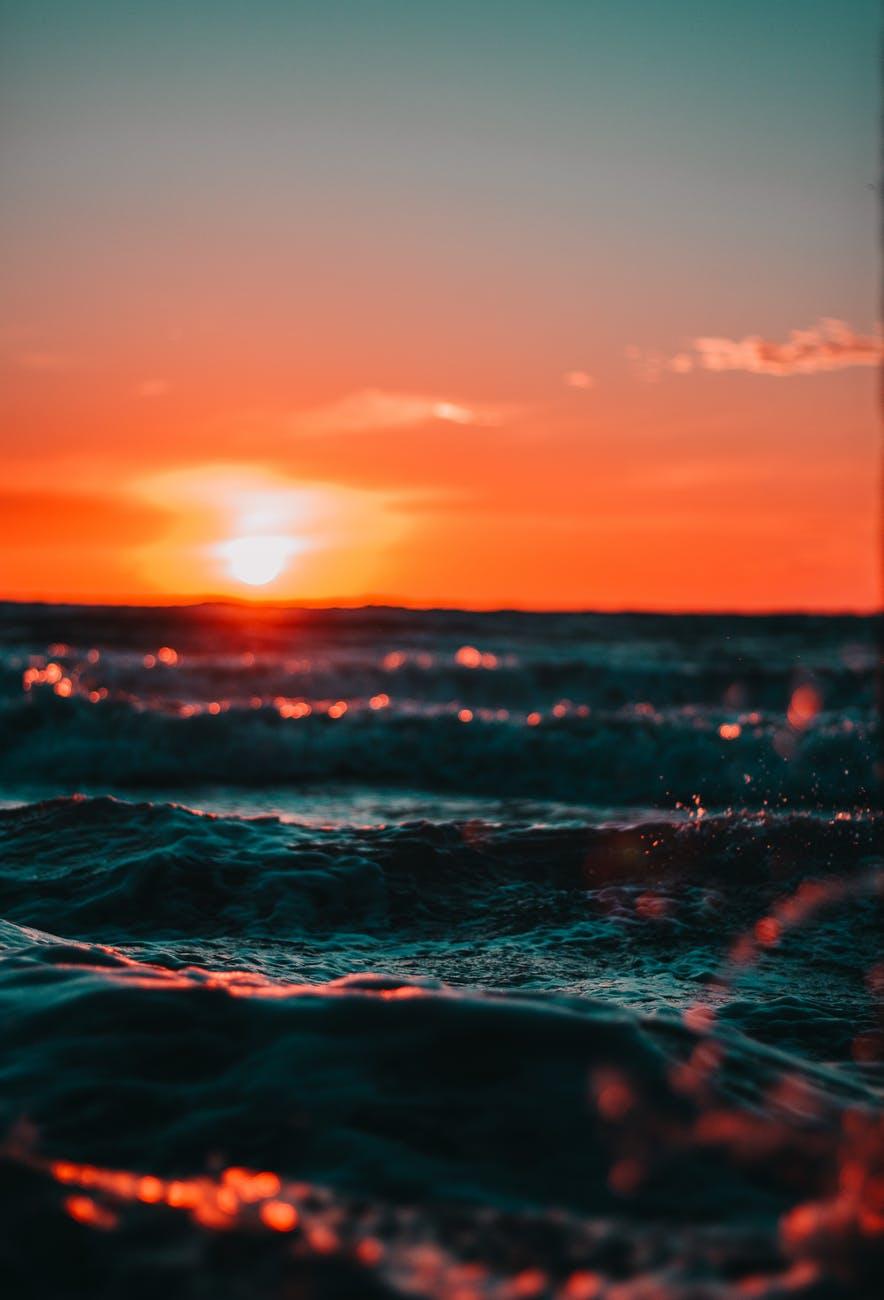 Orange sunset on ocean representing surrender